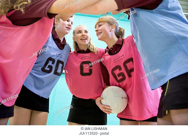 High school students talking in huddle before netball game
