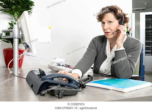 Call center employee listening attentively to the question asked by a caller