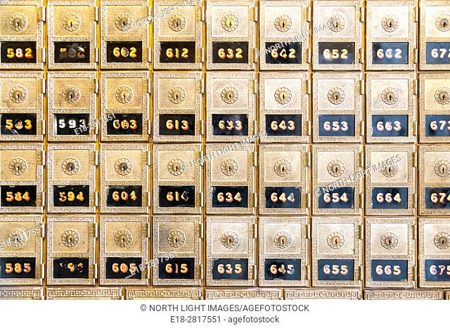 USA, CA, Petaluma. Array of brass post office boxes in the local post office