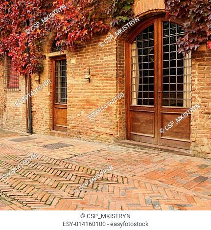picturesque street in small old tuscan town in autumnal colors, Certaldo, Italy, Europe