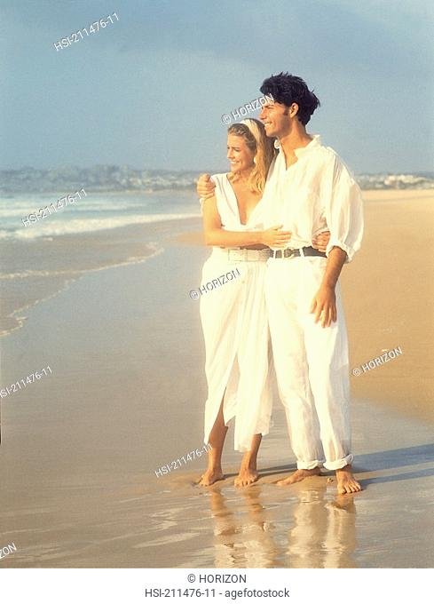 Front view of young couple on beach
