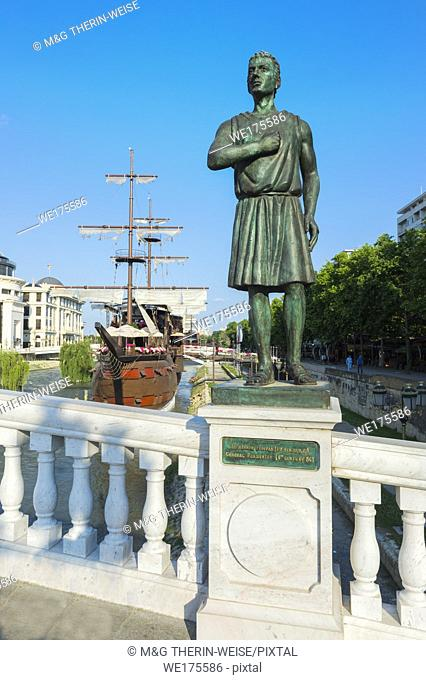 Galleon ship restaurant and bar on Vardar River and General Pakmenion statue, Skopje, Macedonia