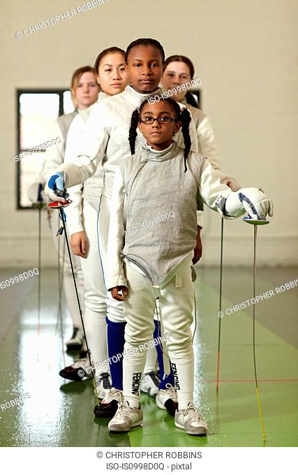 Female fencers standing in line