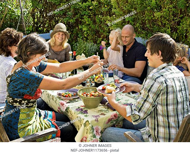 Family having meal at outdoors