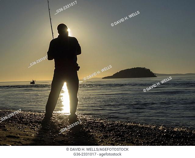 Silhouette of man fishing during sunset at Deception Pass, Oak Harbor, Washington, United States