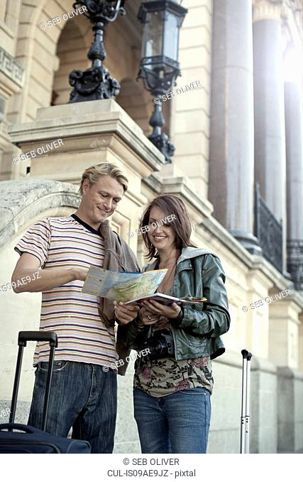 Young couple reading map, Cape Town, South Africa