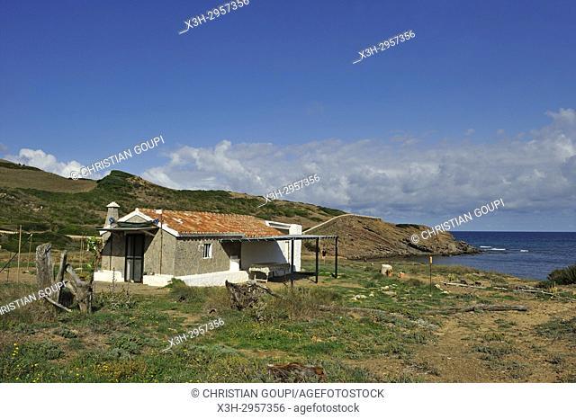 fisherman house at Cala Mica inlet near Cape Cavalleria on the North Coast of Menorca, Balearic Islands, Spain, Europe