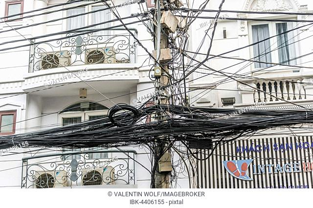 Chaotic bundle of power and telephone lines, Ho Chi Minh City, Vietnam