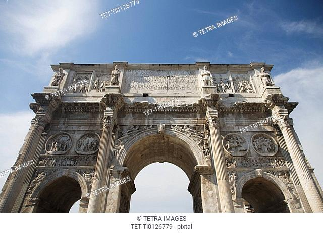 Low angle view of the Arch of Constantine, Italy