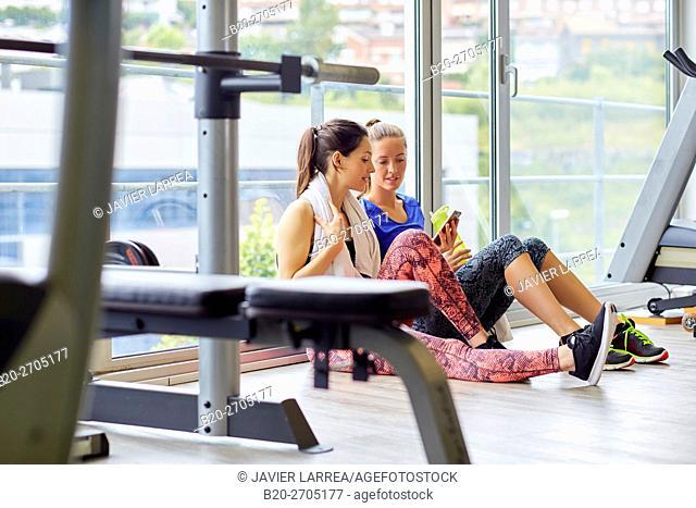 Women resting in gym