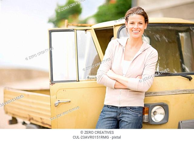 Woman leaning on a piaggio ape