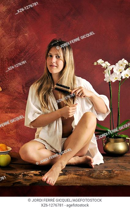 young woman combing