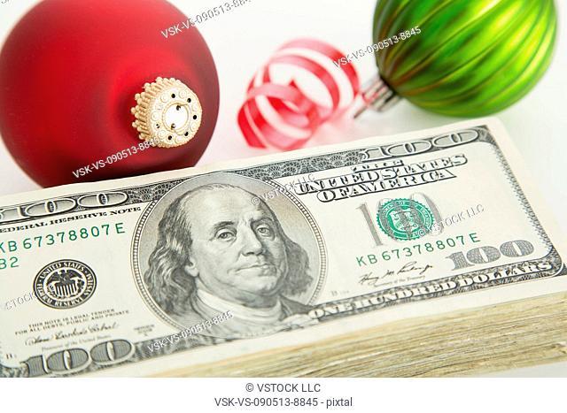 Studio shot of banknotes and Christmas ornaments