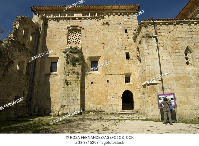 Facade with tourist woman, Cistercian Monastery of Santa Maria de Rioseco, XIII Century, Villarcayo, Valle de Manzanedo, Las Merindades, province of Burgos