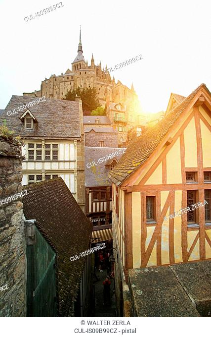 View of timber framed houses and Mont Saint-Michel, Normandy, France