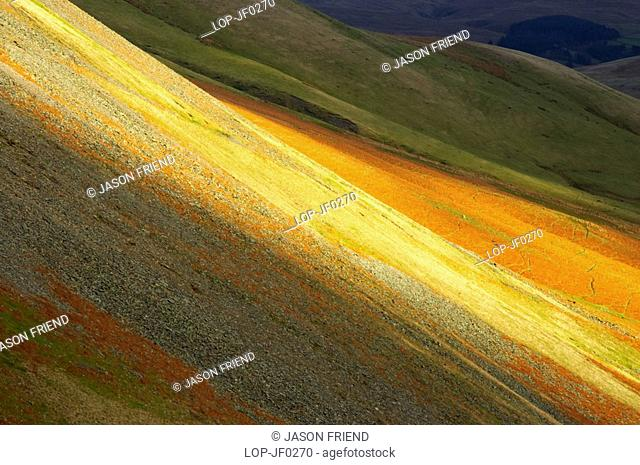 England, Cumbria, Sedburgh, A shaft of light illuminates the hills viewed from the Howgills