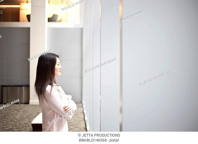 Japanese businesswoman standing in hotel lobby