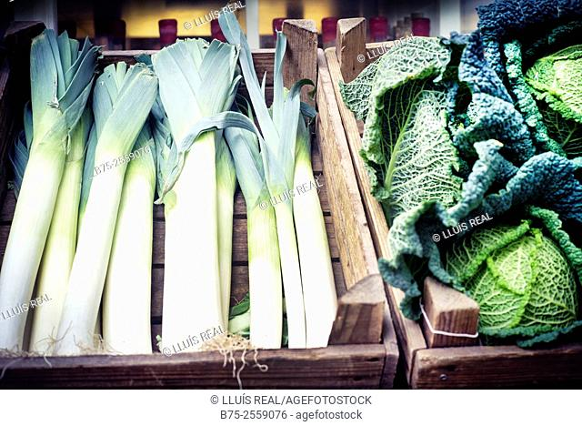 Wooden boxes with organic vegetables. Leeks and cabbage