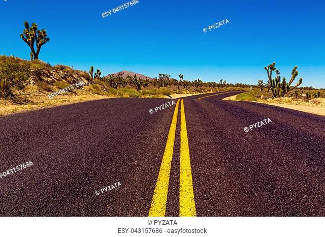 Famous Route 66 going through Mojave Desert in California