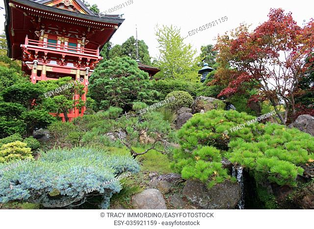 Japanese pagodas and stone lantern in a landscaped Japanese garden in California, USA