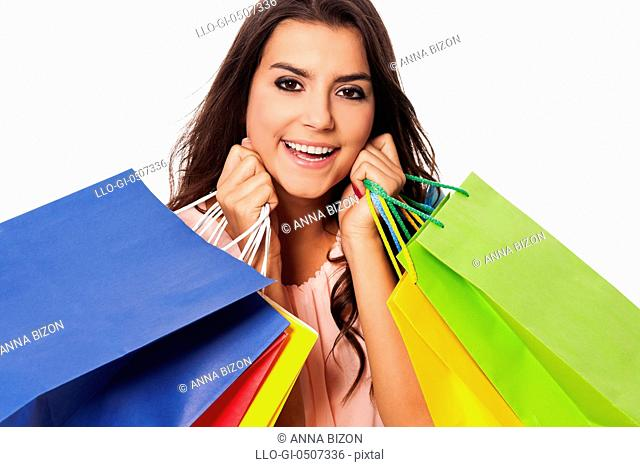 Happy woman with full of shopping bags, Debica, Poland