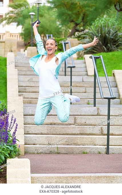 Woman exercising on stairs outdoor