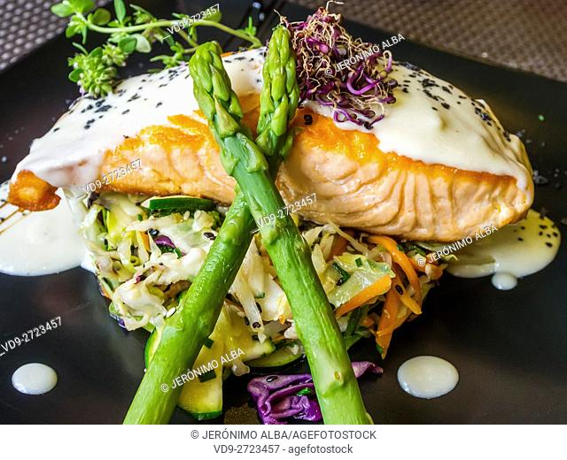 Dish grilled salmon with asparagus and vegetables, restaurant. Málaga capital, Costa del Sol, Andalusia Spain. Europe