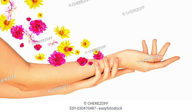 Female arms with colorful flowers isolated on white background
