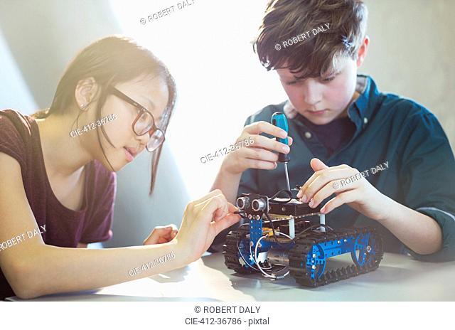 Students assembling robotics in classroom