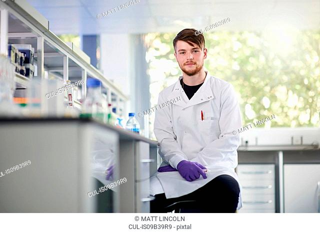 Portrait of scientist in laboratory looking at camera