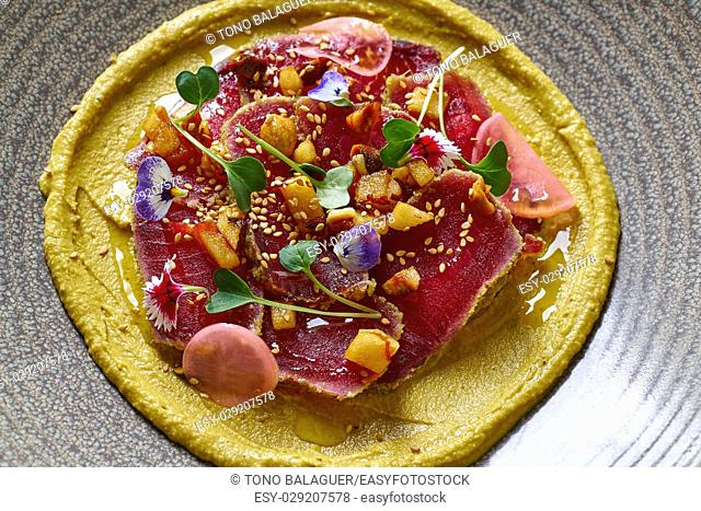 Humus with marinated tuna Moroccan recipe on wooden table