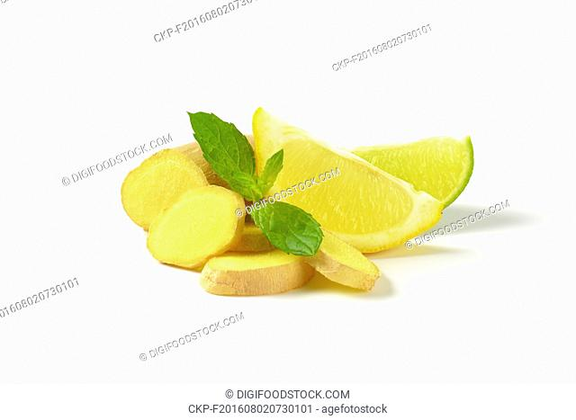 sliced ginger with lemon and lime on white background