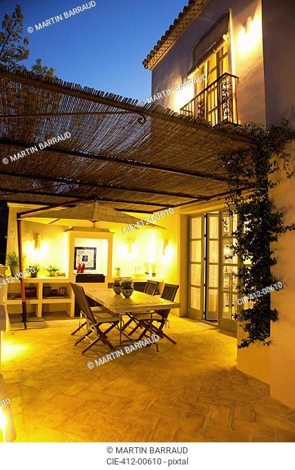 Illuminated patio of luxury villa