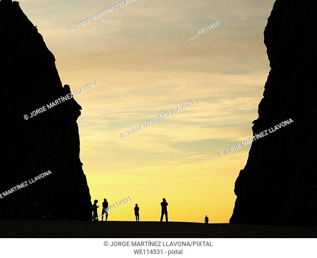 Group of people at a beach in Majorca during sunset