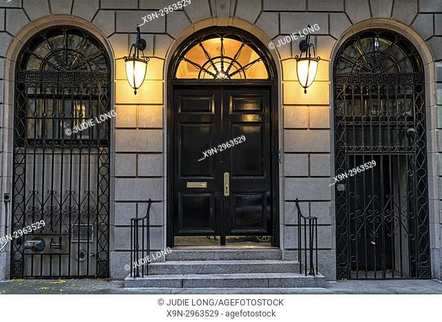 New York City, Manhattan, Upper East Side. Close Up of a a Mansion Entrance at Twilight. Lights On
