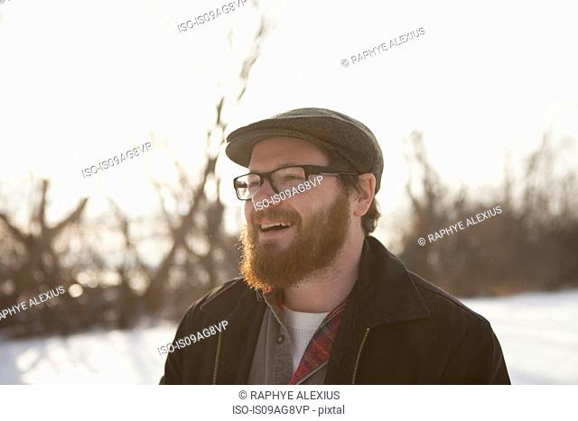 Portrait of young man in winter sunlight