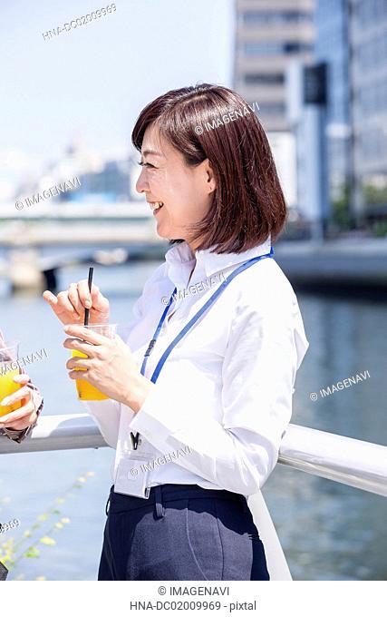 Business women talking outside