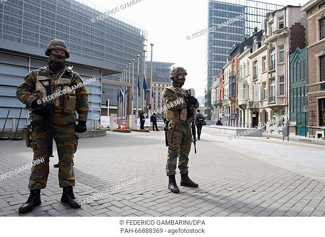 Security forces secure the area surrounding the European Commission building inBrussels, Belgium, 22 March 2016. At least 26 people have been killed on the...