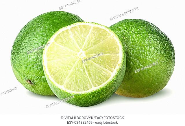 Half and two whole limes isolated on white background