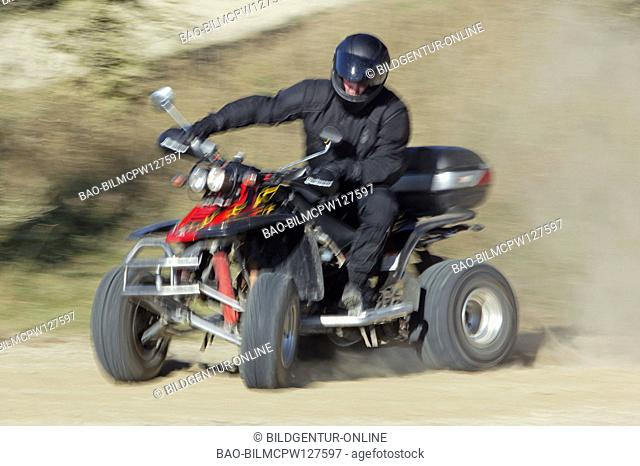 man driving with quad on country road