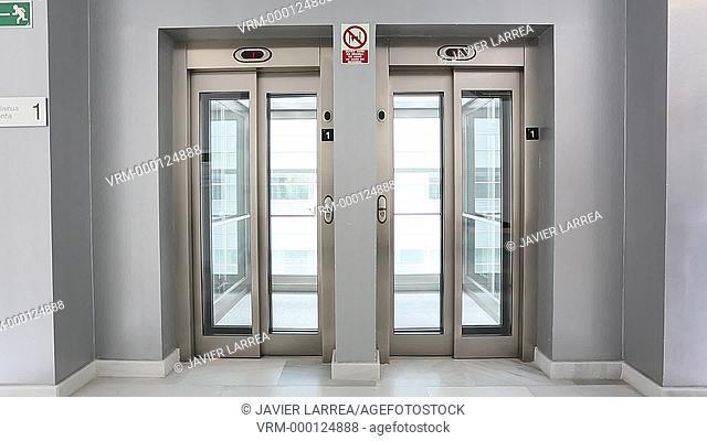 Four executives taking the elevator, Office building, Business, San Sebastian Technology Park, Donostia, San Sebastian, Gipuzkoa, Basque Country, Spain