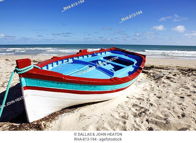 Small boat on tourist beach the Mediterranean Sea, Djerba Island, Tunisia, North Africa, Africa