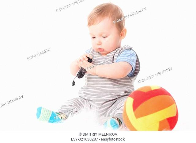 Sweet small baby with mobile phone