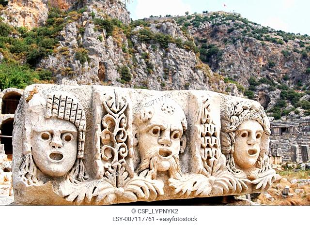 Ancient,abandoned masks and tombs in Myra.Turkey