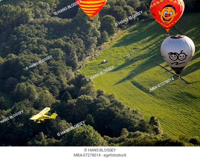 Aerial view, 20th Warsteiner Montgolfiade, almost 200 balloons rising into the sky, Warstein, Sauerland, North Rhine-Westphalia, Germany, Europe