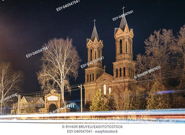 Vitebsk, Belarus. Night View Of Old Cathedral Of St. Barbara On Background Starry Sky