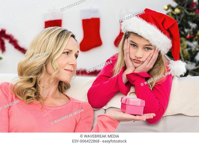 Festive mother and daughter with gift