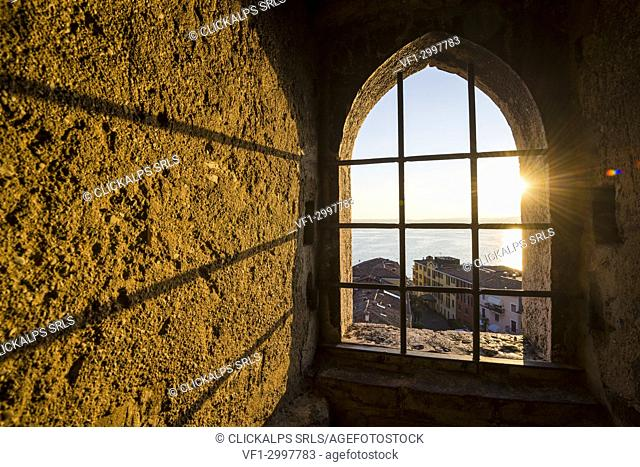 Sirmione, lake Garda, Brescia province, Lombardy, Italy. Inside of the Scaliger Castle's tower at sunset