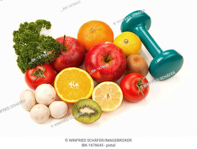 Fruit and vegetables with a dumbbell
