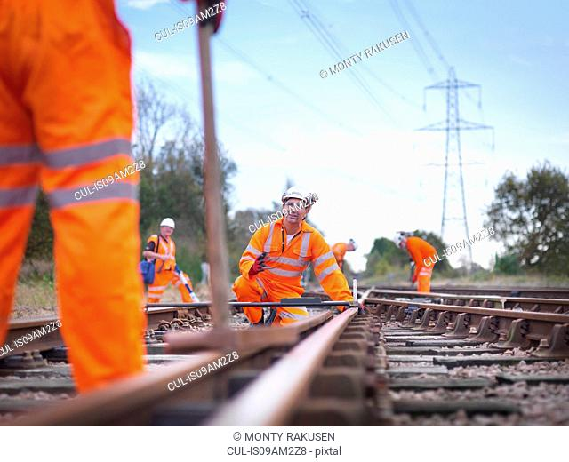 Railway maintenance workers inspecting track